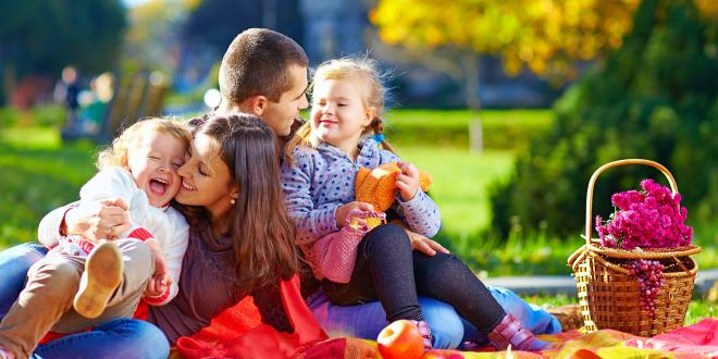 a family having a picnic in the park
